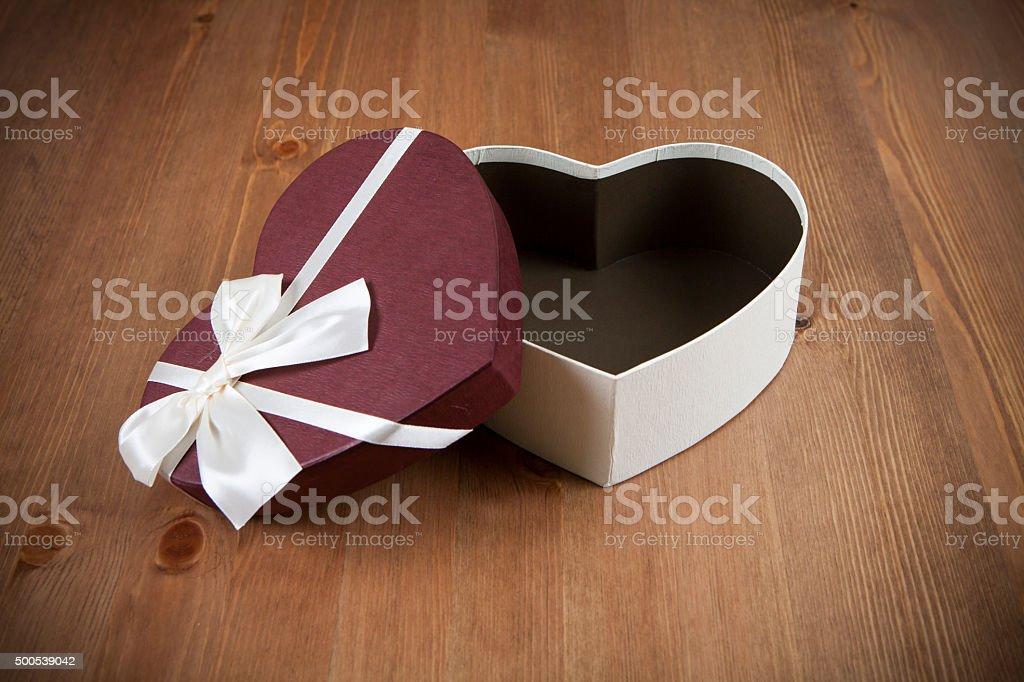 Empty Heart Box on wood stock photo