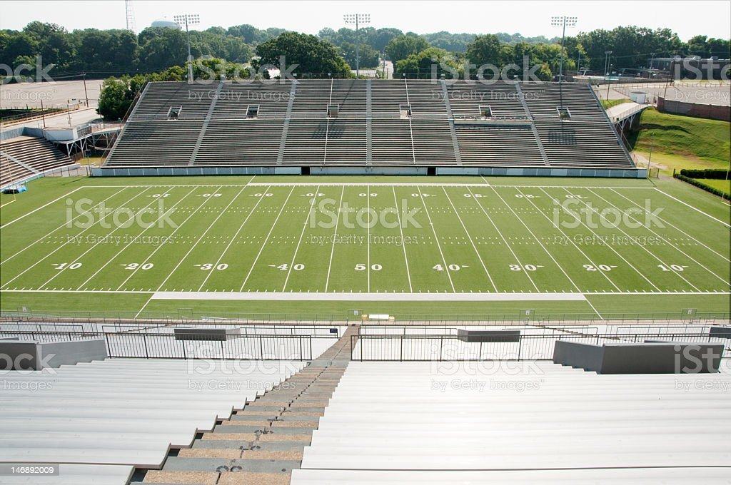Empty high school football stadium royalty-free stock photo