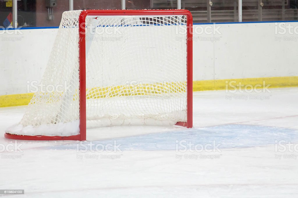 Empty hockey net at a small town ice arena stock photo