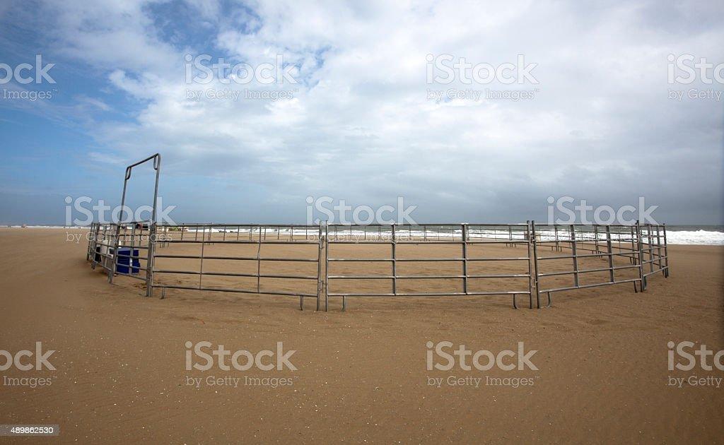 Empty Horse Corral on Beach stock photo