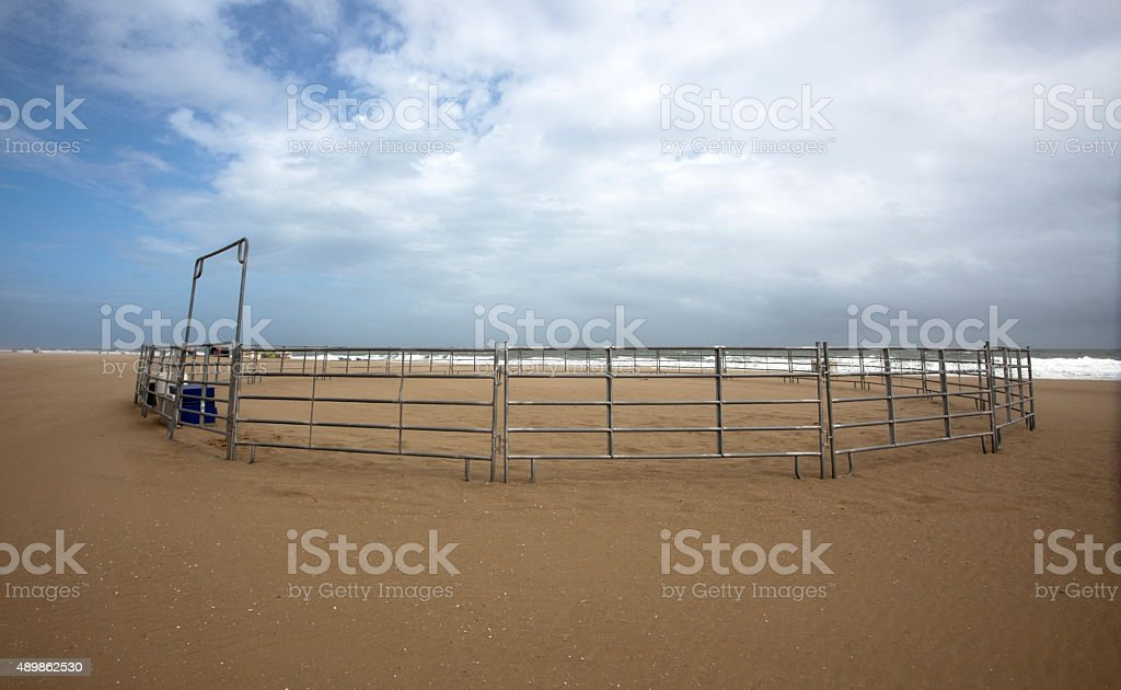Empty Horse Corral on Beach stock photo