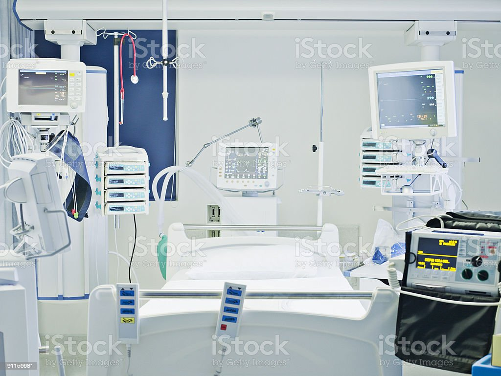Empty hospital bed in intensive care stock photo