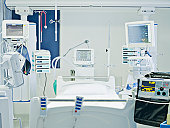 Empty hospital bed in intensive care