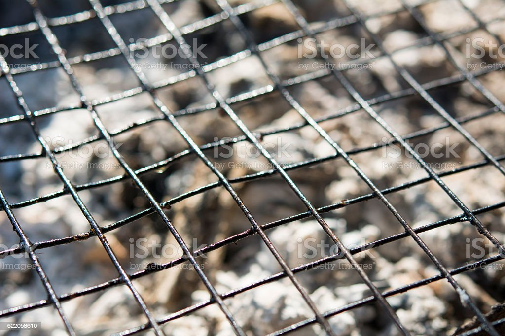 Empty Hot Barbecue Iron Grill With Glowing Charcoal stock photo