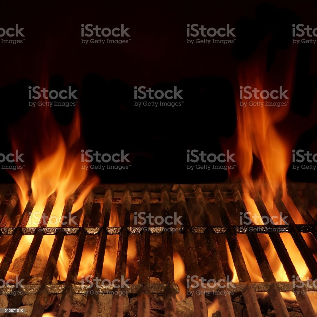 Empty Hot Charcoal Barbecue Grill With Bright Flame Isolated stock photo