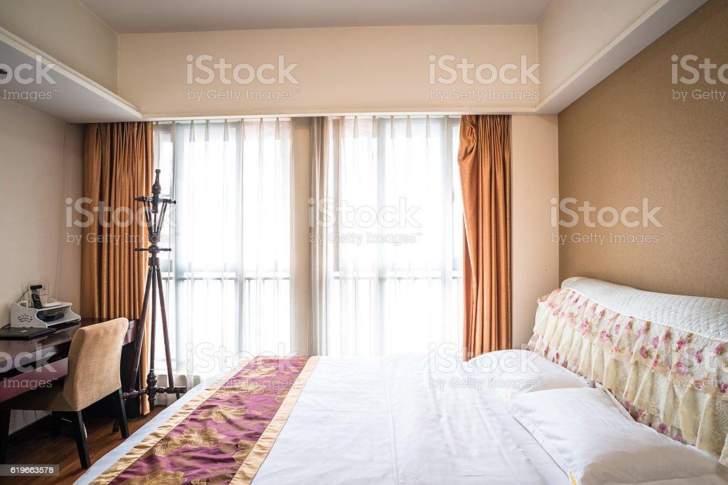 Empty hotel bedroom stock photo