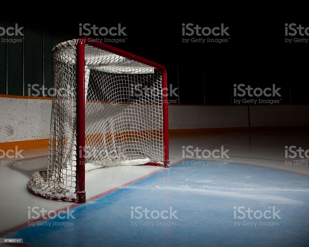 Empty ice hockey venue with the focus on the net stock photo