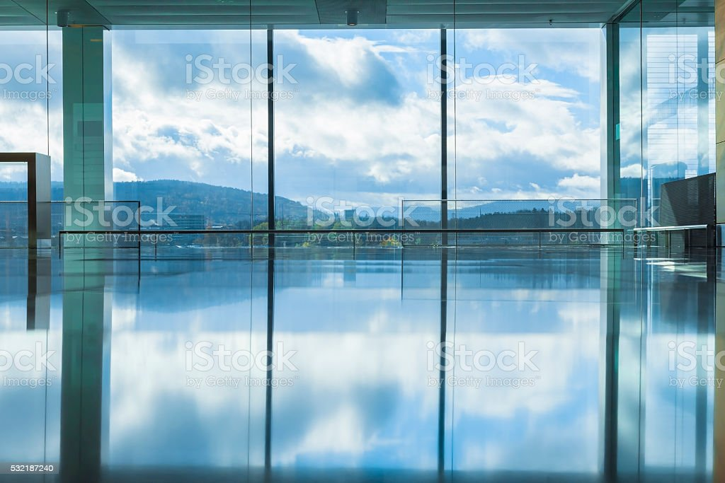 Empty interior of modern building with reflection of blue sky stock photo