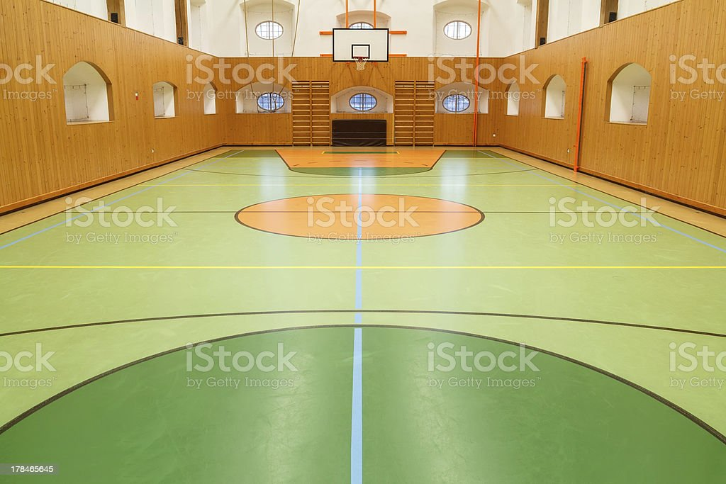 Empty interior of public gym with basketball court stock photo