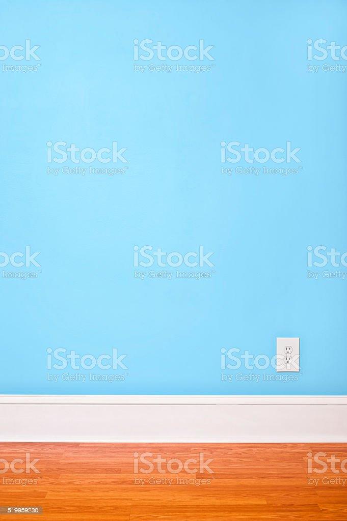 Empty interior room with light blue walls and hardwood floor stock photo