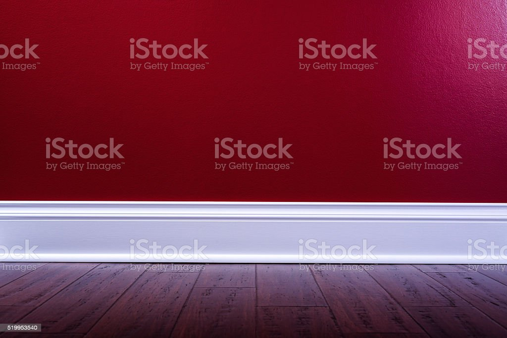 Empty interior room with red walls and wood floor stock photo