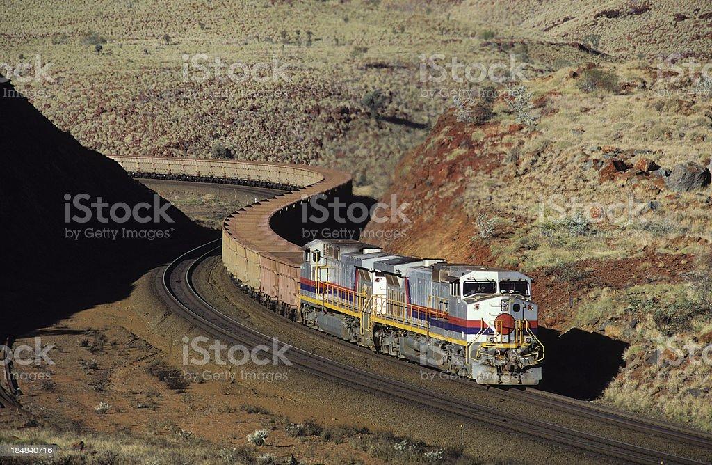 Empty iron ore train winding through spectacular hills stock photo