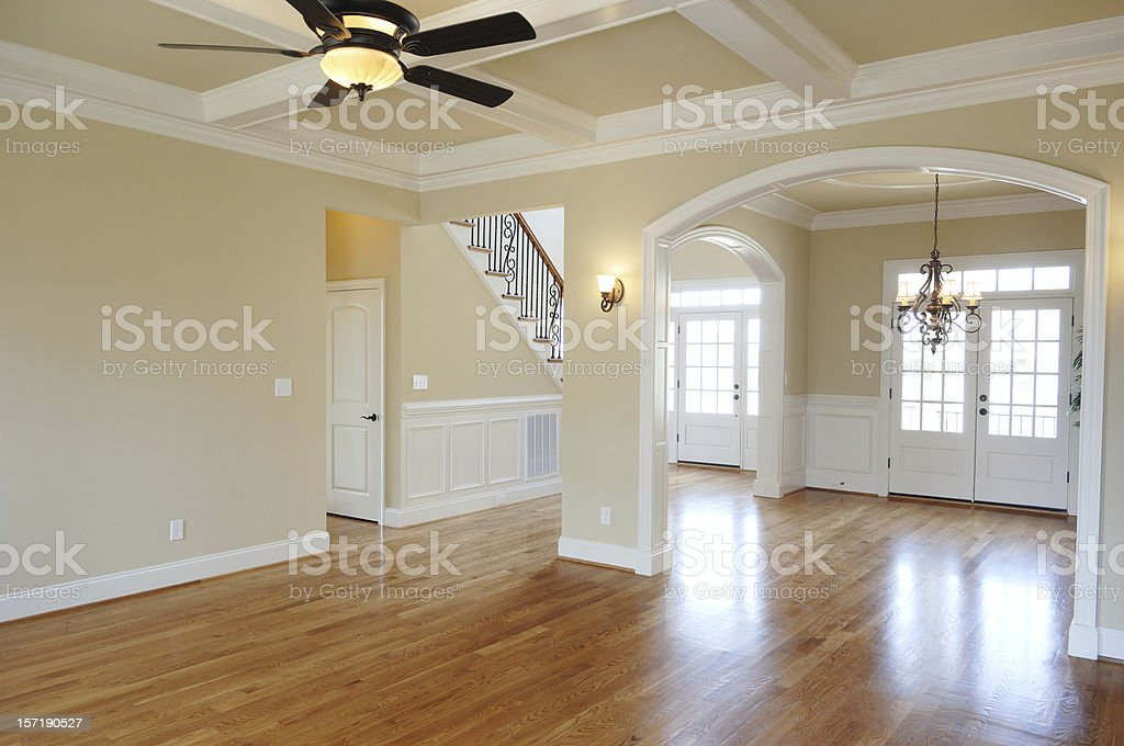 Empty large room with shiny wooden floor and clean walls stock photo