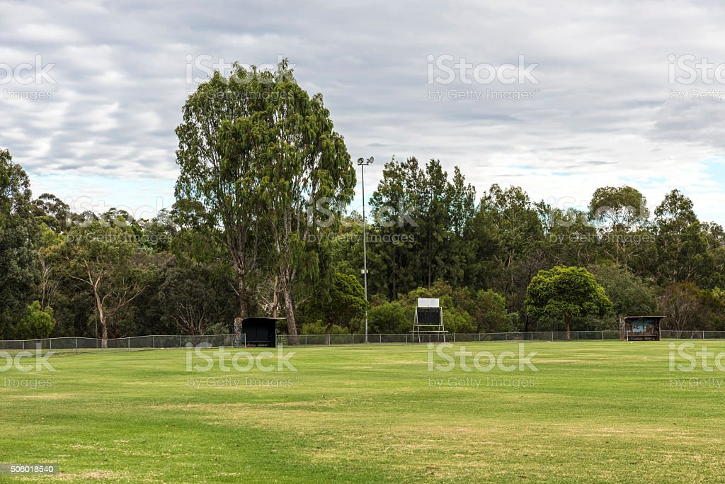 Empty Large Sports Field with Cloudscape stock photo