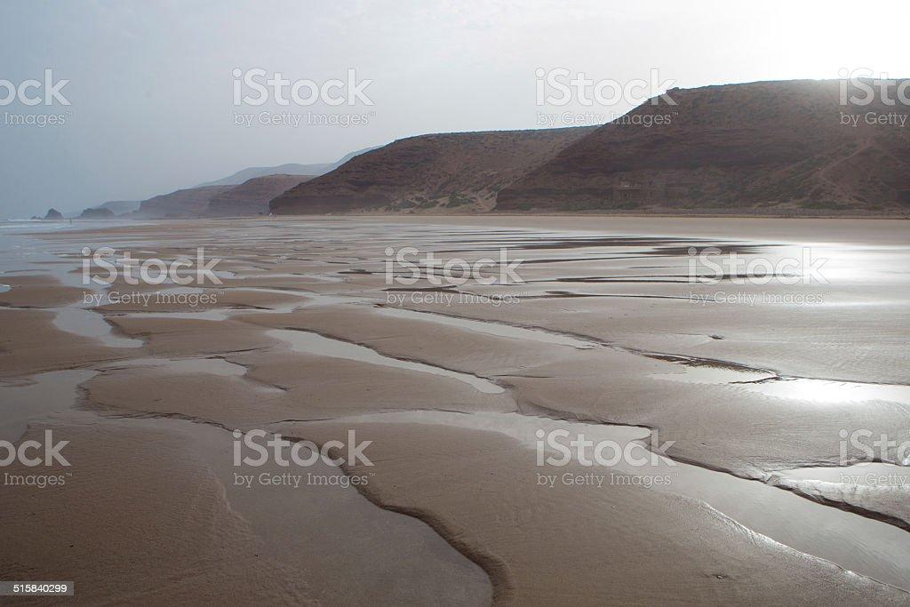 Empty Legzira beach early in the morning stock photo