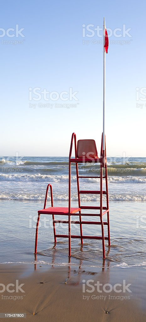 Empty lifeguard chair at a beach in Lazio, Italy royalty-free stock photo