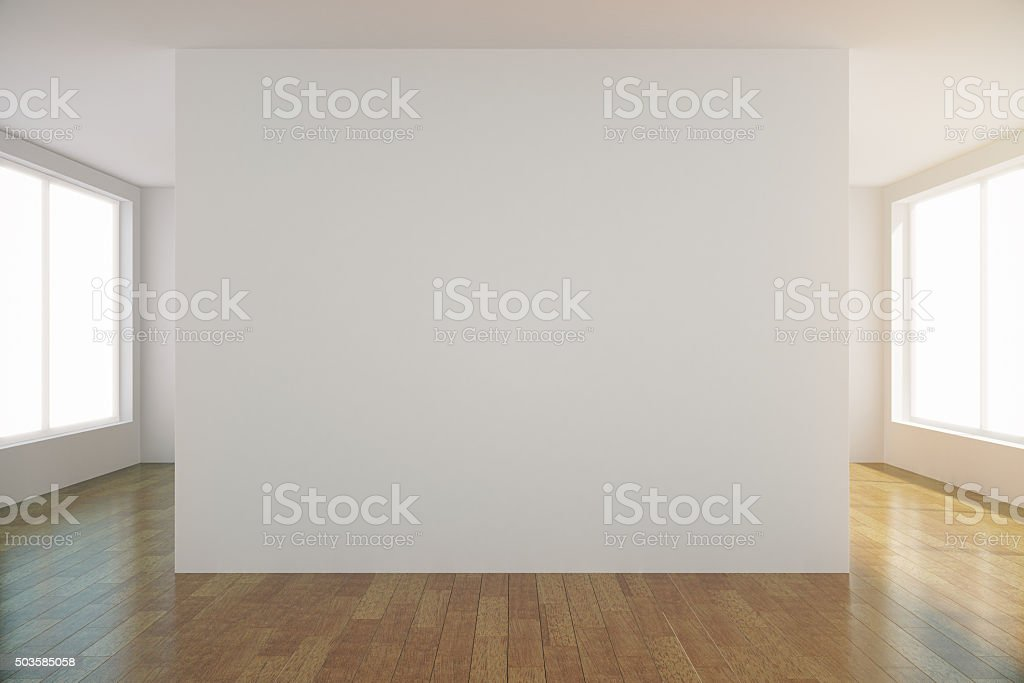 Empty light room with blank white wall in the center stock photo