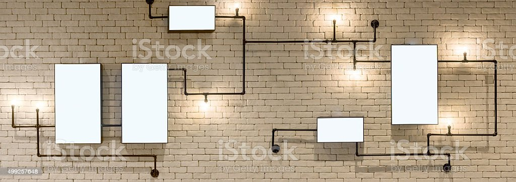 Empty ligthbox on brick wall stock photo