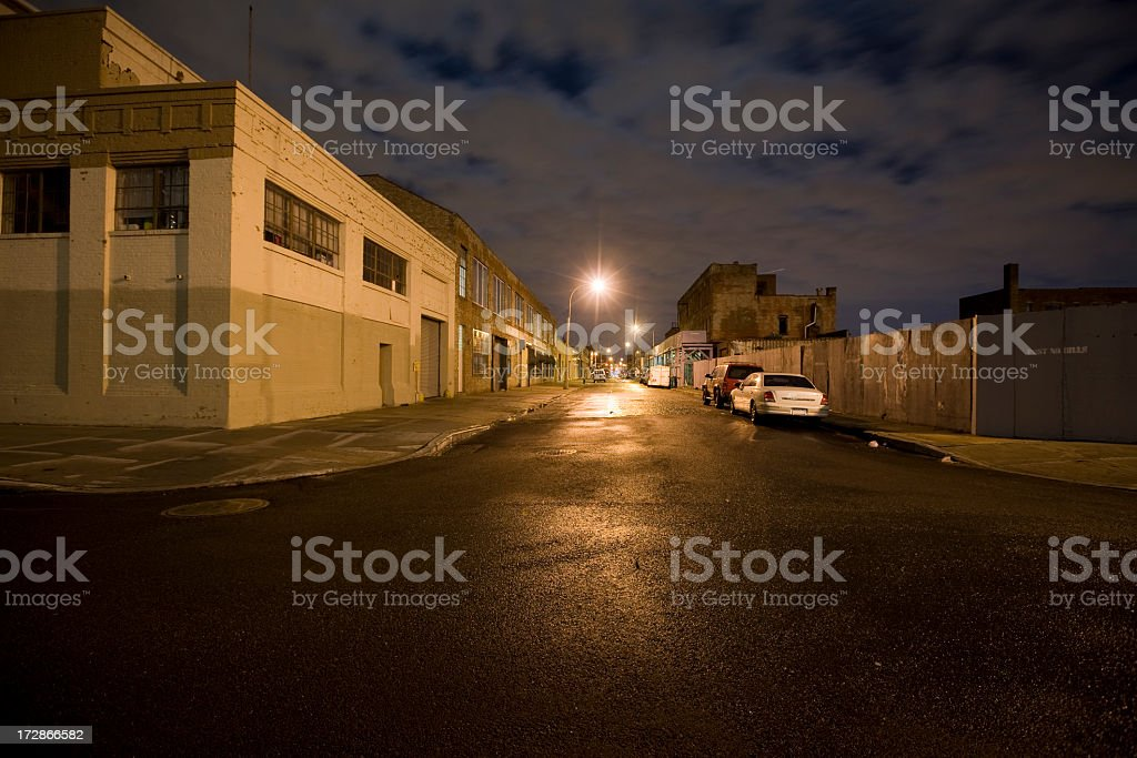 Empty lit street on a cloudy night royalty-free stock photo