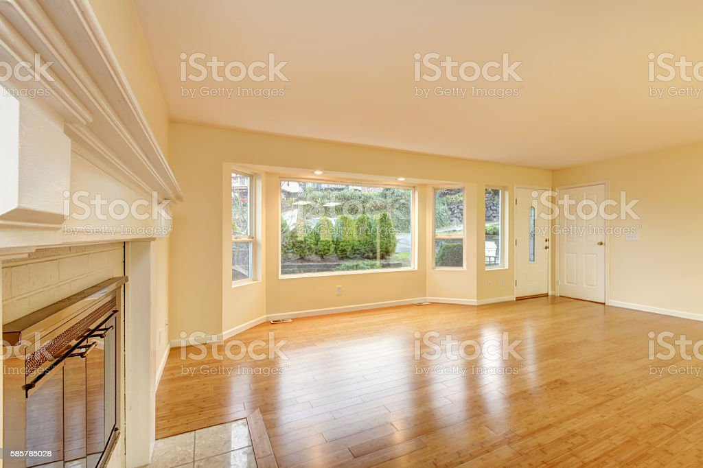 Empty living room interior with polished hardwood floor. stock photo