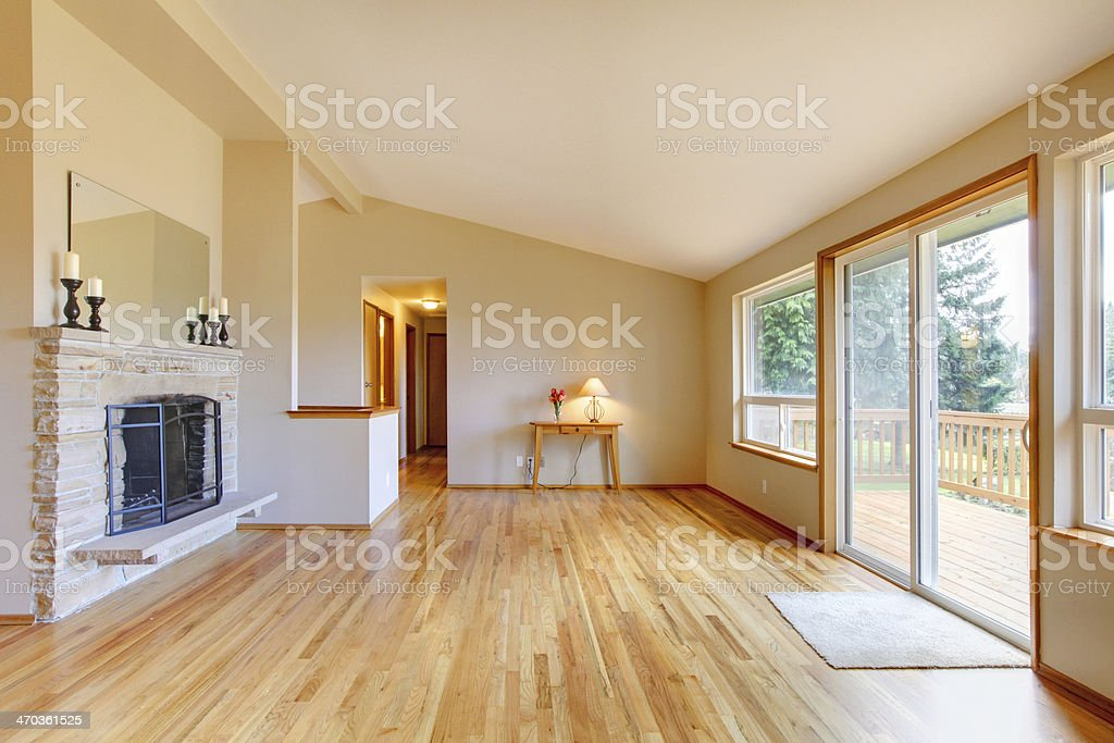 Empty living room with a fireplace and glass sliding door stock photo