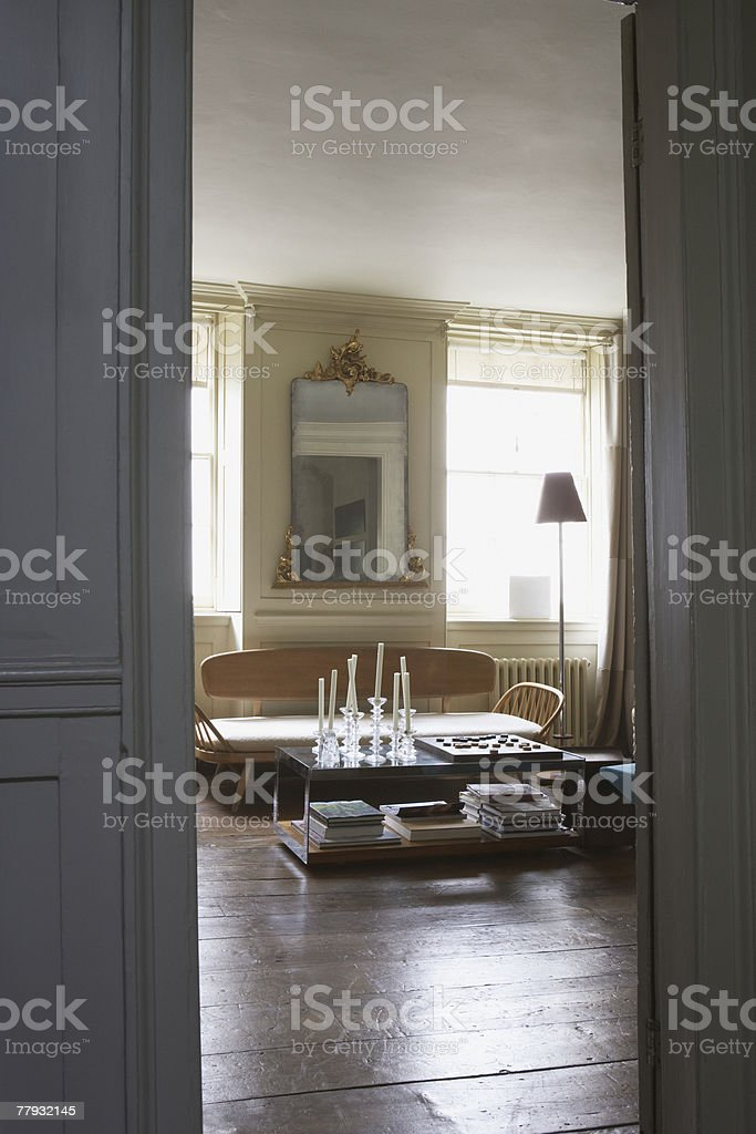 Empty living room with checkerboard on coffee table royalty-free stock photo