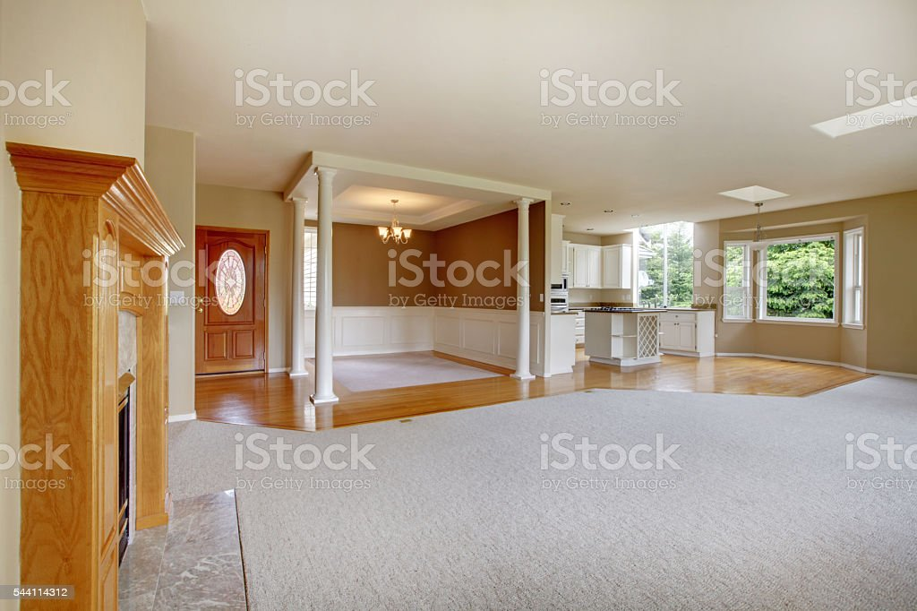Empty living room with connected kitchen, with hardwood. stock photo