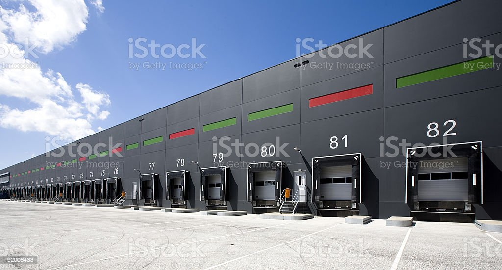 Empty loading docks in a modern building numbered up to 82 stock photo