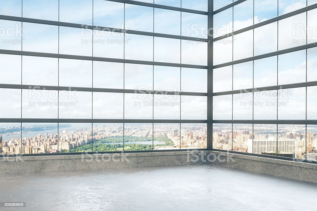 Empty loft style room with glassy windows and city view stock photo