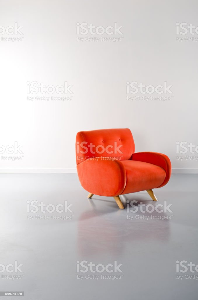 Empty Loft WIth Orange Armchair stock photo
