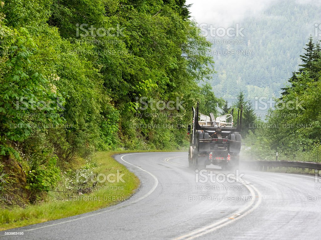 Empty Log Truck Rural Road Port Angeles Washington State stock photo
