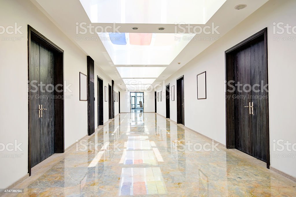 Empty long corridor stock photo