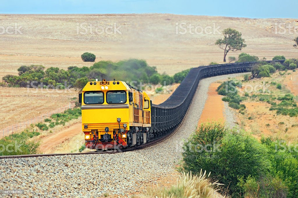 Empty magnetite iron ore train in rolling hills stock photo