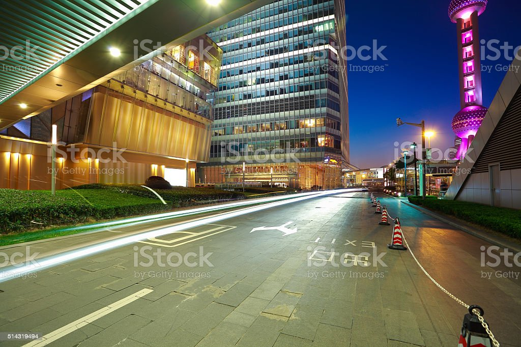 Empty marble floor road surface with modern buildings background stock photo