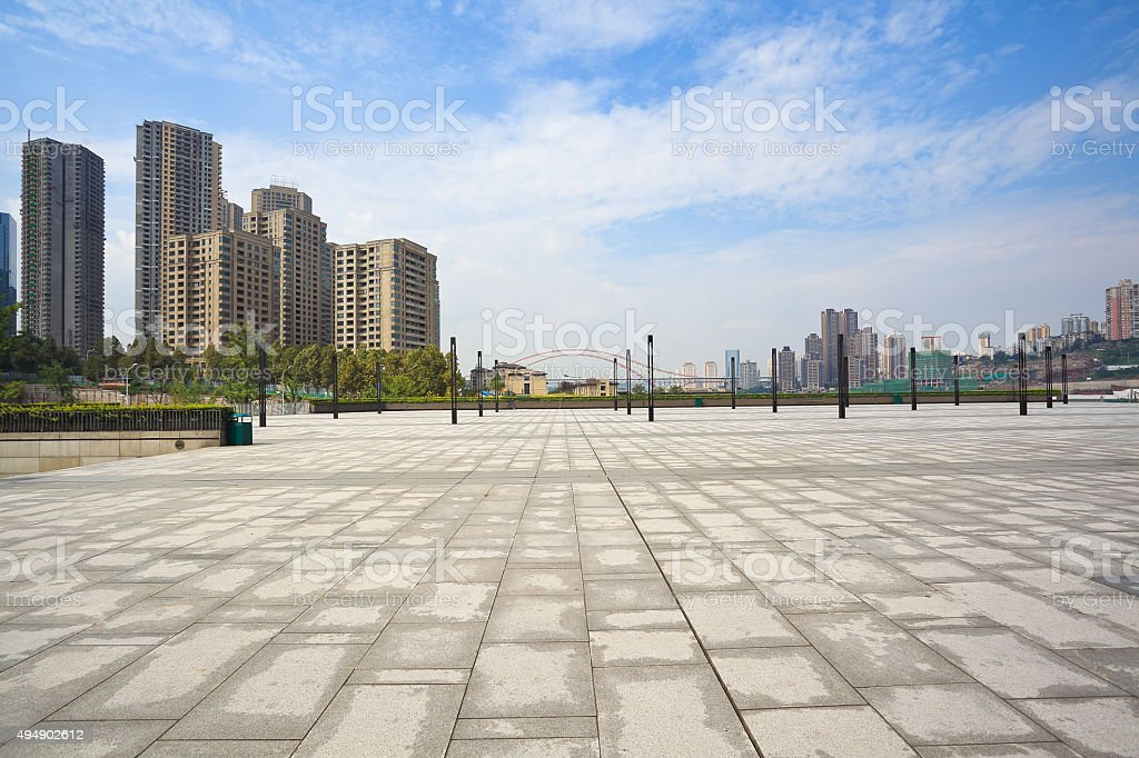 Empty marble floor with city building background stock photo