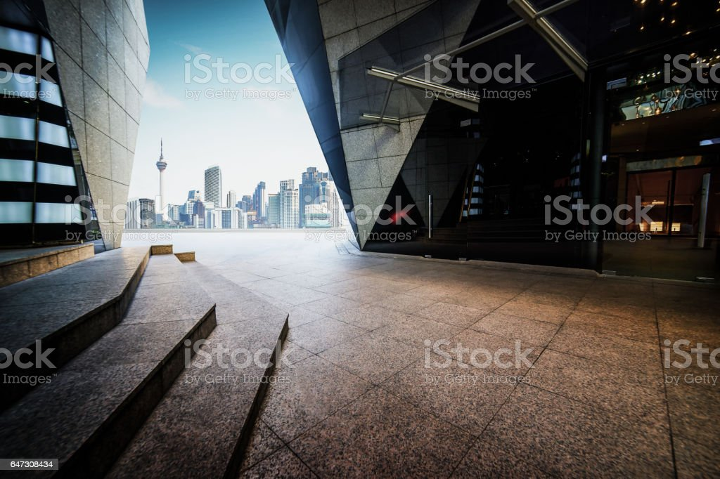 Empty marble stair and floor front of modern polygon design buildings. stock photo