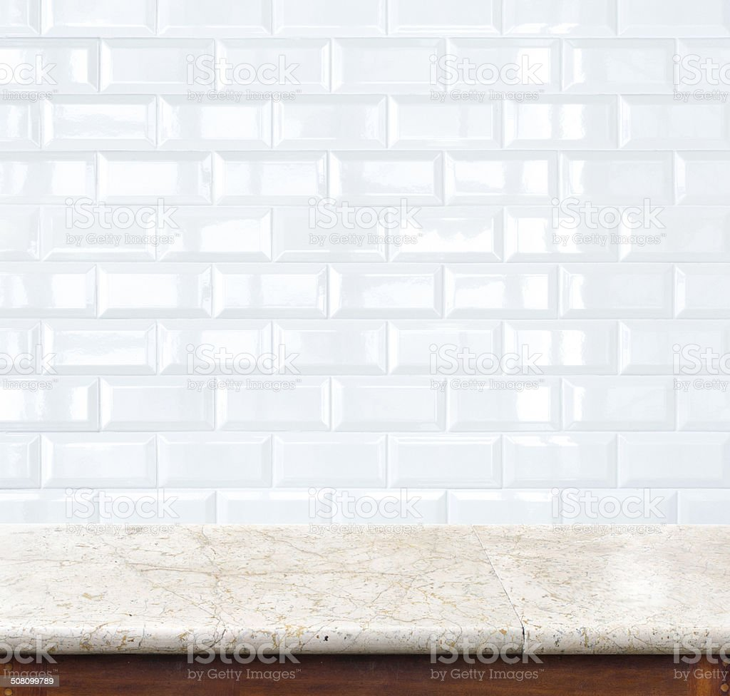 Empty marble table and ceramic tile brick wall stock photo