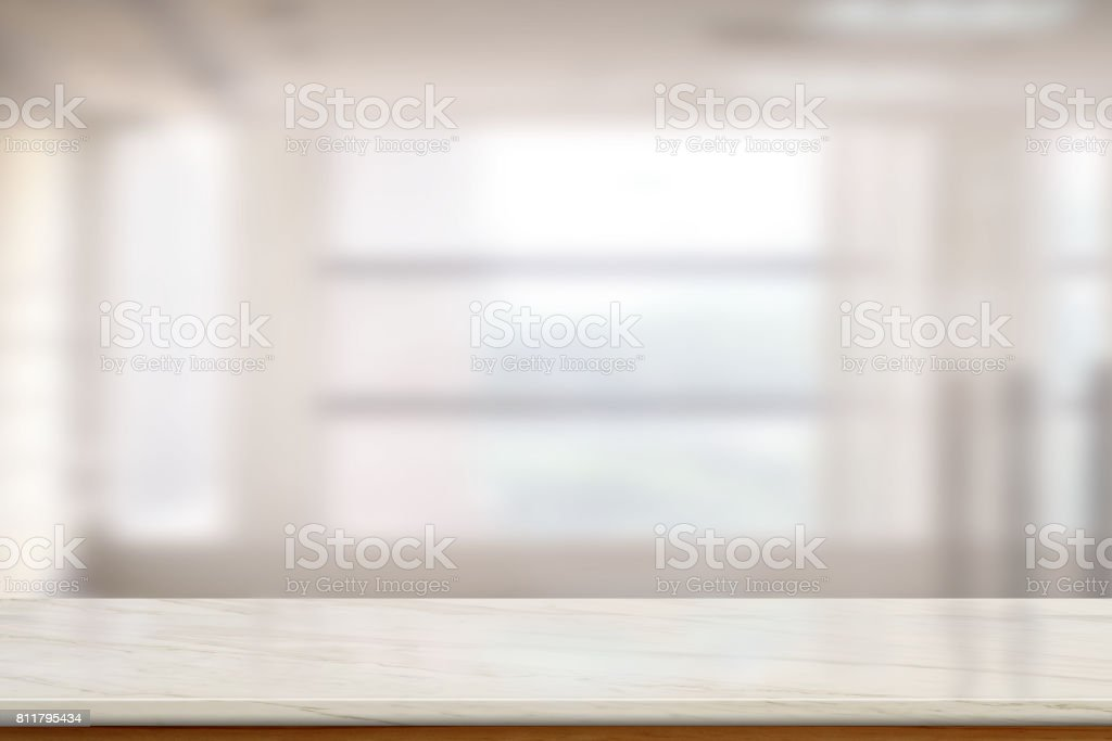 Empty Marble table top or marble counter in blurred empty office...