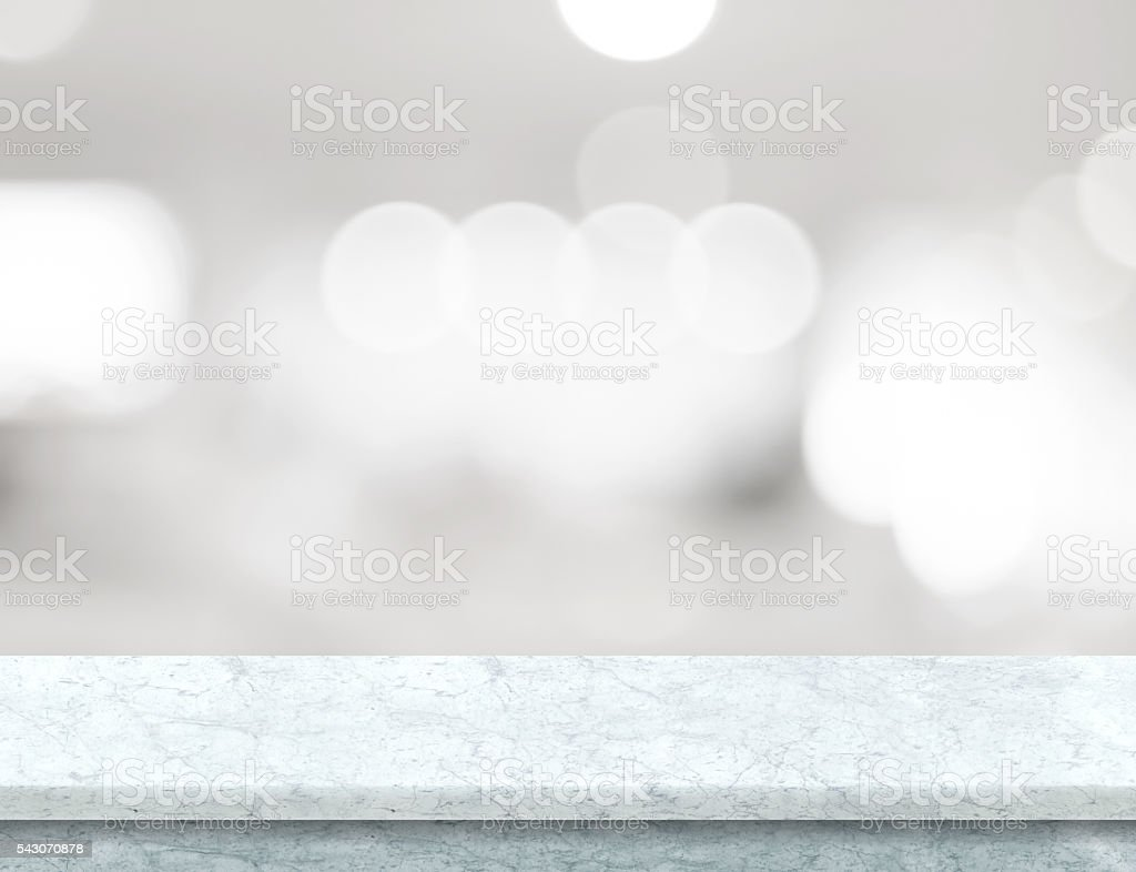 Empty marble table top with abstract blur stock photo