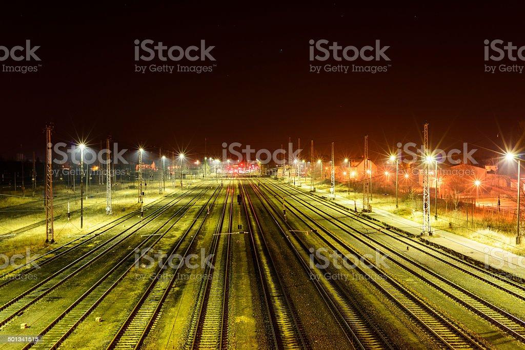 Empty marshalling yard at night stock photo