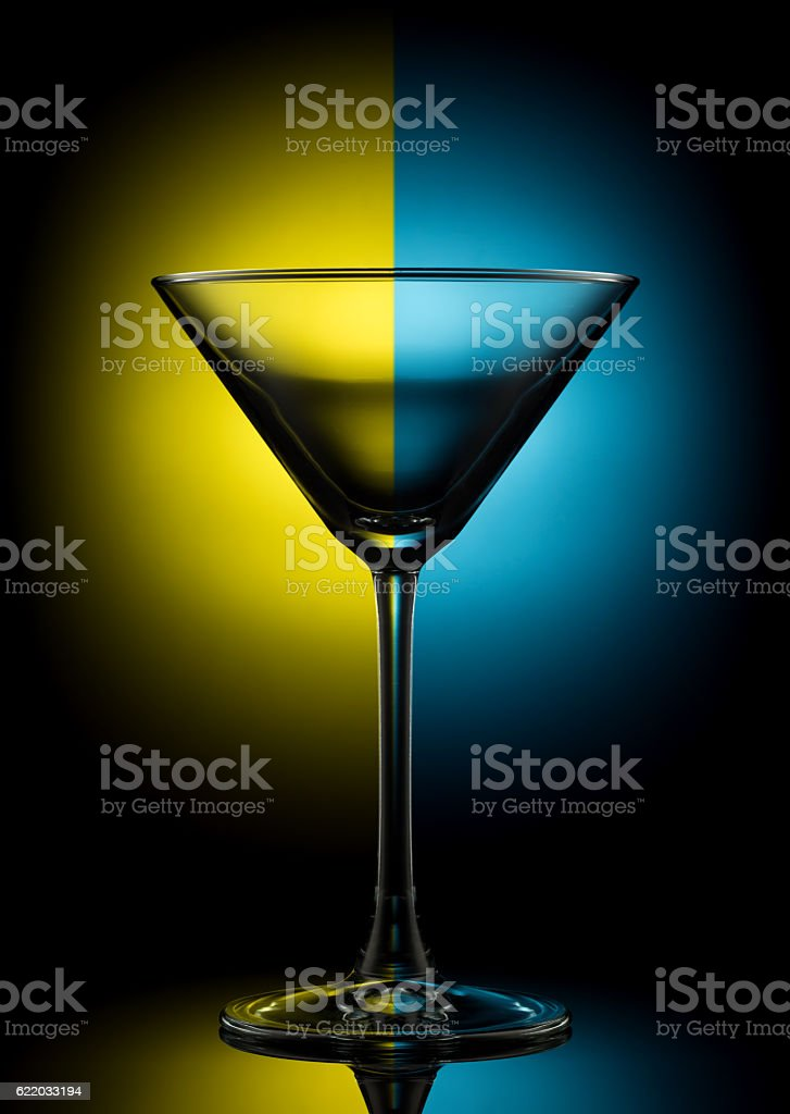 Empty martini glass on color stock photo