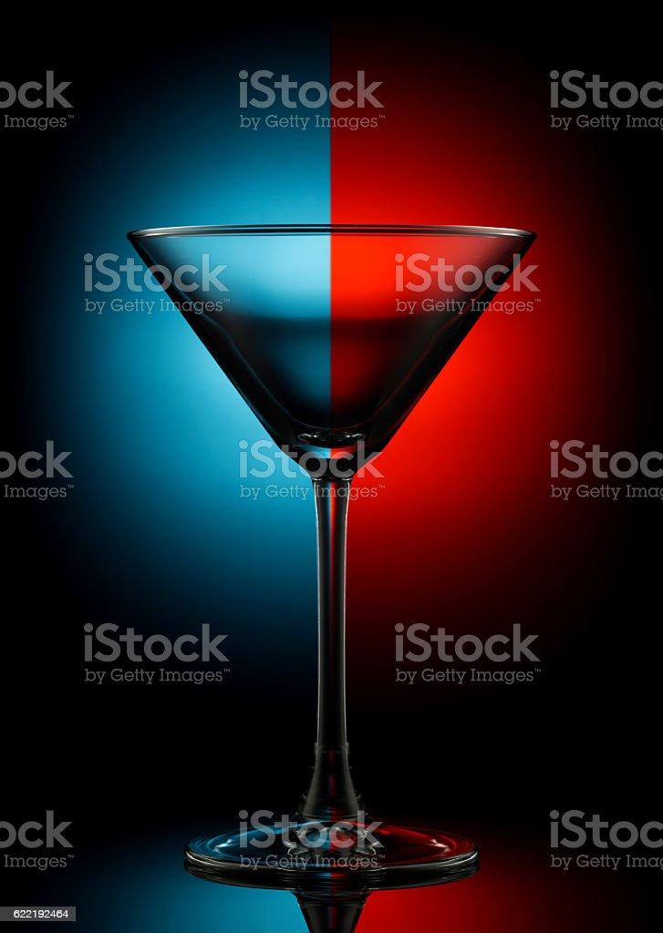 Empty martini glass on color stock photo