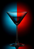 Empty martini glass on color