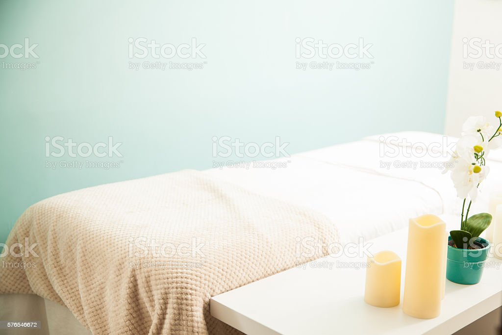 Empty massage bed at a spa clinic stock photo