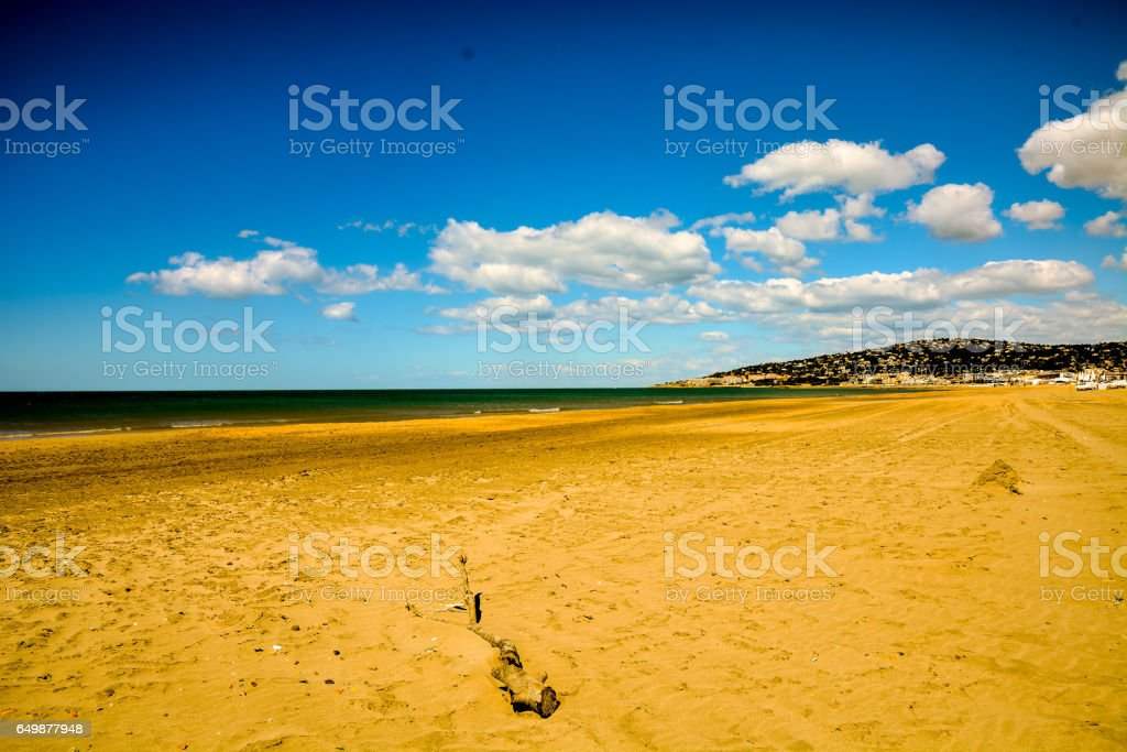 Empty mediterranean sand beach in south france stock photo