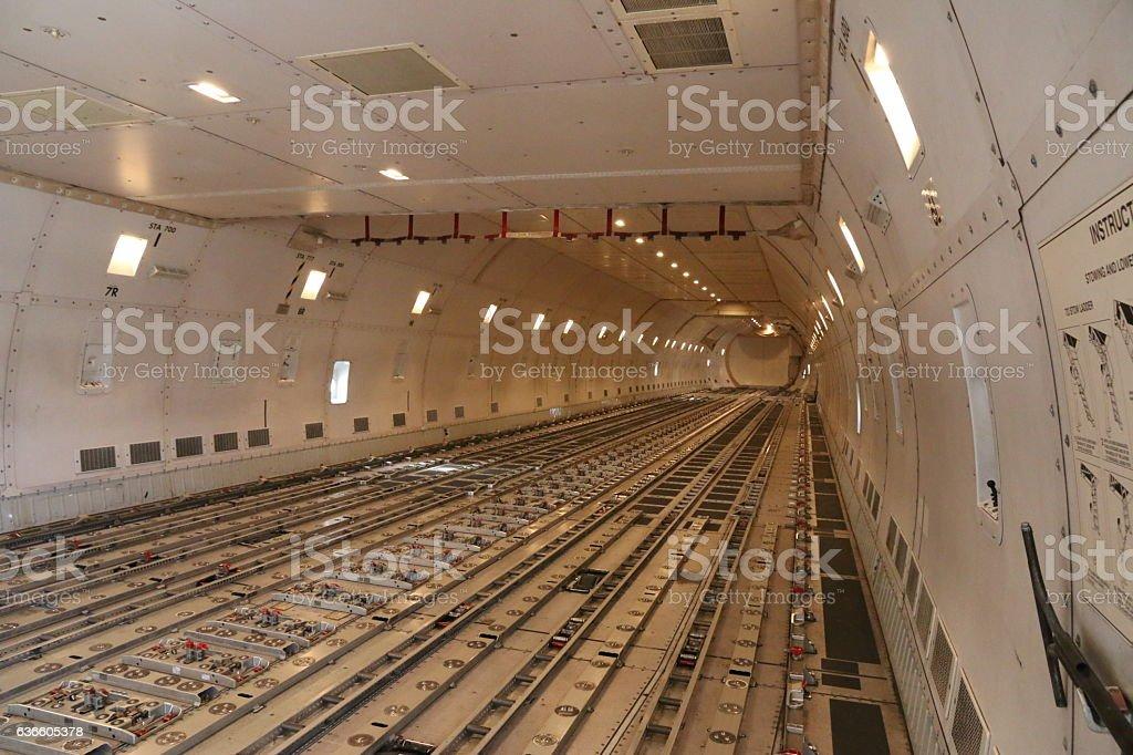 Empty modern civil airplane cargo hold stock photo