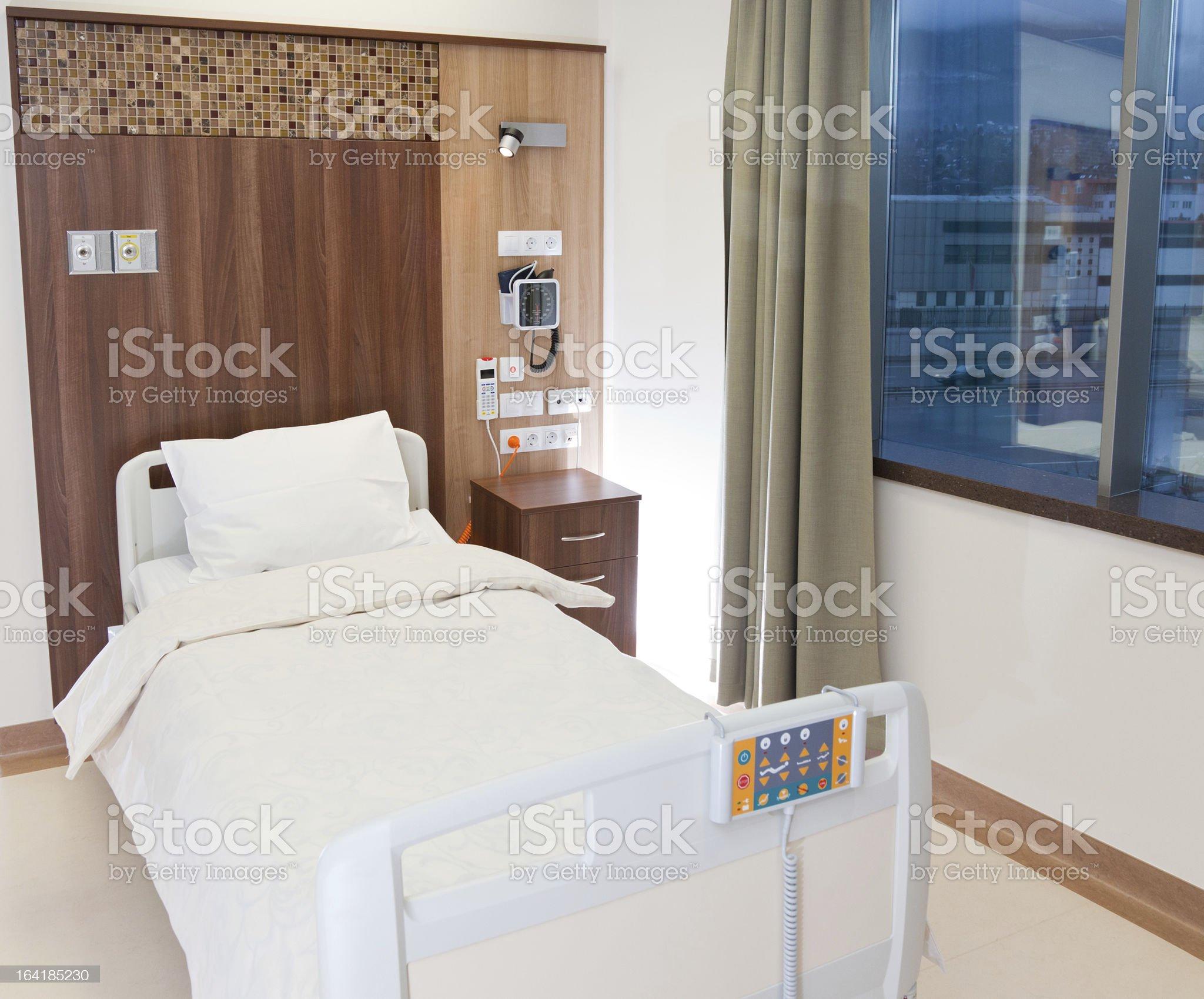 Empty modern hospital bed royalty-free stock photo
