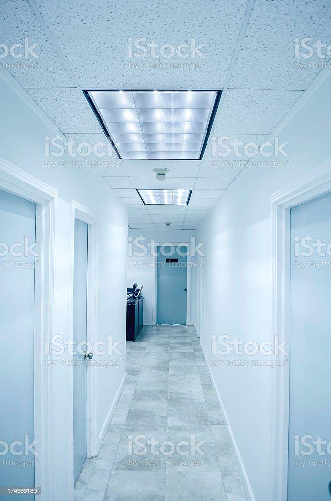empty modern office corridor leading to door royalty-free stock photo