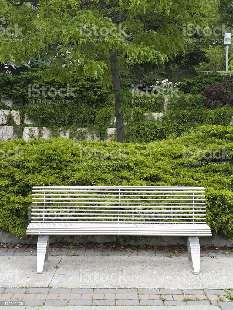 Empty modern park bench royalty-free stock photo