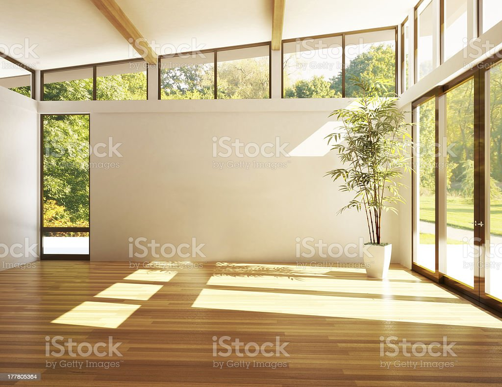 Empty modern room with sun-filled windows stock photo
